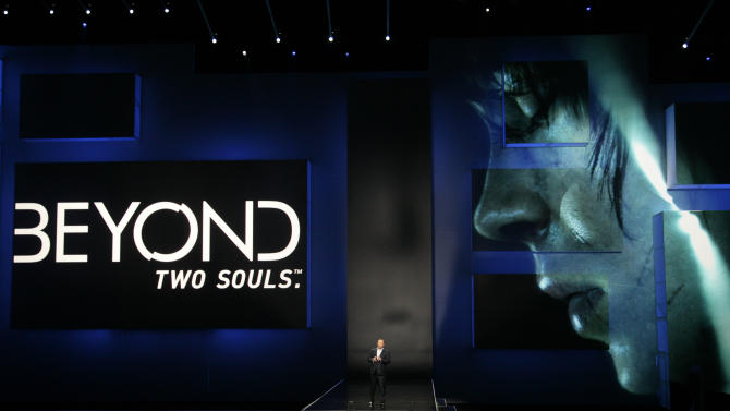 """Jack Tretton, President and CEO of Sony Computer Entertainment America, introduces the game """"Beyond Two Souls"""" featuring Ellen Page at the Sony Electronic Entertainment Expo (E3) news conference in Los Angeles, Monday, June 4, 2012. (AP Photo/Jason Redmond)"""