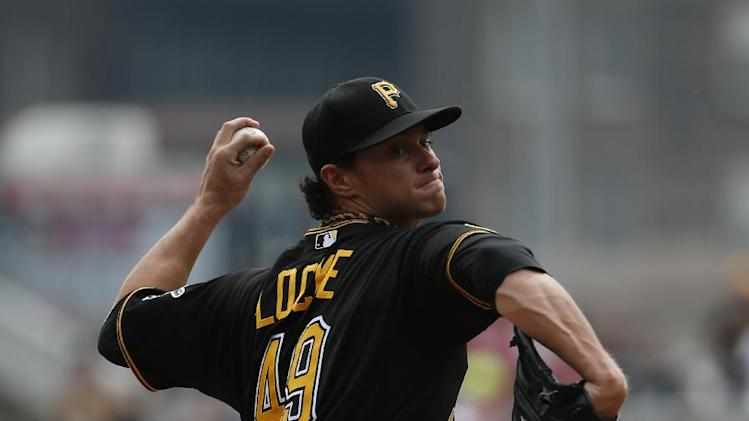 Pittsburgh Pirates' Jeff Locke (49) delivers during the first inning of a baseball game against the St. Louis Cardinals in Pittsburgh Wednesday, Aug. 27, 2014. (AP Photo/Gene J. Puskar)