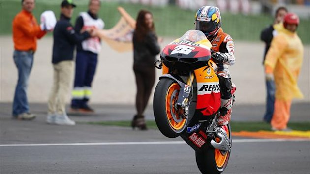 Repsol Honda Team's Spanish rider Dani Pedrosa celebrates after winning the MotoGP race at Ricardo Tormo racetrack in Cheste near Valencia (AFP)