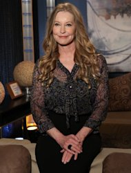 Patrick Swayze&#39;s widow, Lisa Niemi, poses backstage on the set of Access Hollywood Live on January 9, 2012