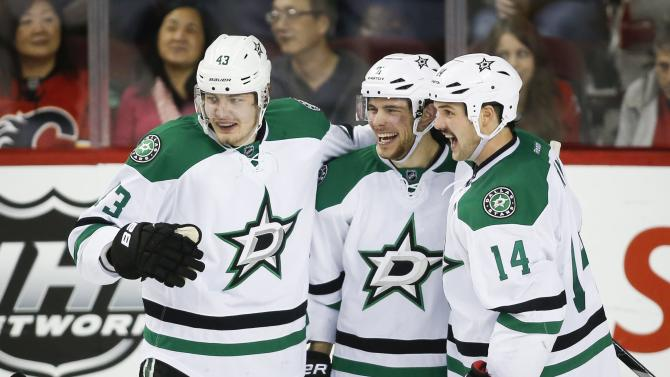 Seguin, Benn score big as Stars top Flames 7-3
