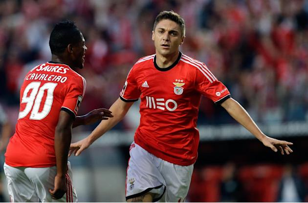 Benfica's Siqueira, from Brazil, celebrates scoring with teammate Ivan Cavaleiro, left, during their Portuguese league soccer match against Nacional, Sunday Oct. 27, 2013, at Benfica's Luz stadium in
