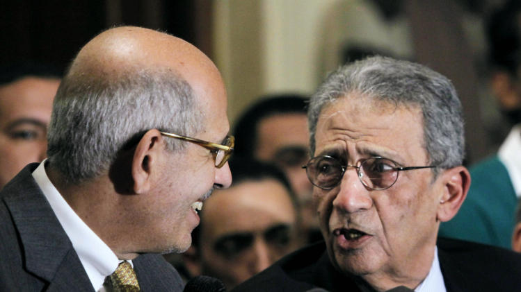 Mohamed El Baradei, left, Nobel peace laureate and former director of the U.N.'s nuclear agency, speaks with former Egyptian Foreign Minister and presidential candidate Amr Moussa during a news conference following the meeting of the National Salvation Front in Cairo, Monday, Jan. 28, 2013. The group, Egypt's main opposition coalition, has rejected President Mohammed Morsi's call for dialogue to resolve the country's political crisis, demanding that he first make deep concessions to break what they call the monopoly that Islamists have tried to impose on power. (AP Photo/Amr Nabil)