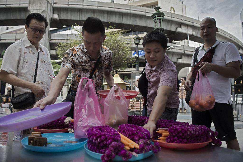 Chinese still flock to 'lucky' Bangkok shrine hit by blast