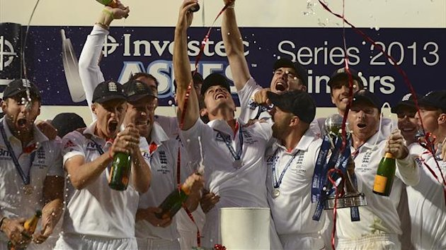 England's captain Alastair Cook lifts the replica Ashes urn (Reuters)