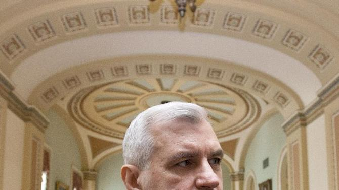 Sen. Jack Reed, D-R.I., pauses off the Senate floor on Capitol Hill in Washington, Tuesday, May 8, 2012, before a showdown on the Democratic proposal to keep federally subsidized loan interest rates from doubling for millions of college students.  (AP Photo/J. Scott Applewhite)