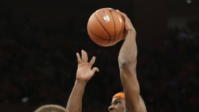 Syracuse's C.J. Fair (5) drives past Georgetown's D'Vauntes Smith-Rivera (4) during the overtime period of an NCAA college basketball game at the Big East Conference tournament Friday, March 15, 2013, in New York. Syracuse won the game 58-55. (AP Photo/Frank Franklin II)