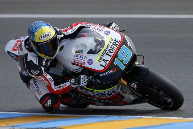 Kalex Moto2 rider Simeon of Belgium takes curve during the third free practice session of the French Grand Prix in Le Mans circuit