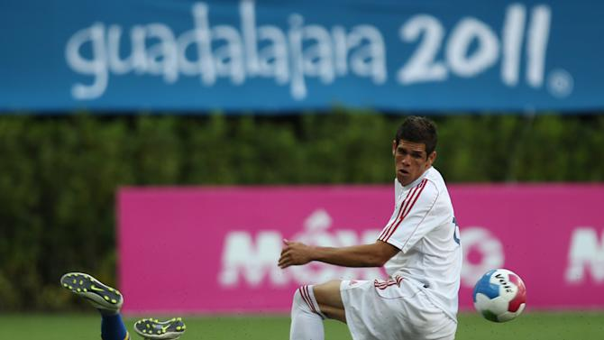 Cuba's Dalain Aira, right, fights for the ball with Brazil's Enrique Ribeiro,on the floor, during a men's soccer match at the Pan American Games in Guadalajara, Mexico, Friday, Oct. 21, 2011.  (AP Photo/Juan Karita)