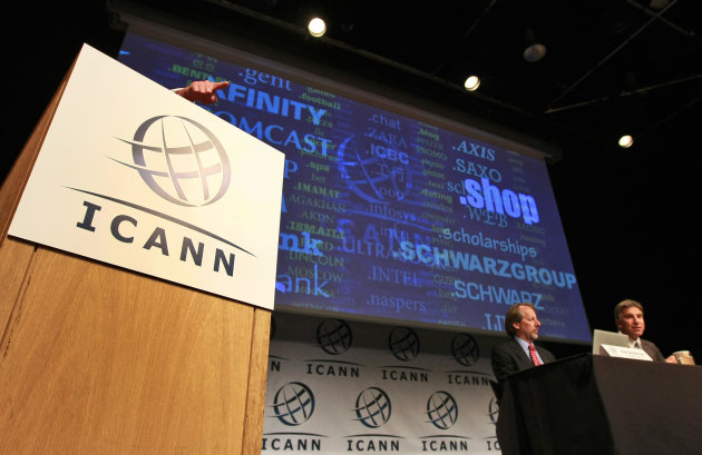 "Internet Corporation for Assigned Names and Numbers, ICANN, President and Chief Executive Rod Beckstrom, left, and Kurt Pritz, Senior Vice President speaks on expanding the number of domain name suffixes during a press conference, London, Wednesday June 13, 2012. Proposals for Internet addresses ending in "".pizza,"" ''.space"" and "".auto"" are among the nearly 2,000 submitted as part of the largest expansion in the online address system. Apple Inc., Sony Corp. and American Express Co. are among companies seeking names with their brands. The expansion will allow suffixes that represent hobbies, ethnic groups, corporate brand names and more. The Internet Corporation for Assigned Names and Numbers announced the proposals for Internet suffixes — the "".com"" part of an Internet address — in London on Wednesday. Among the 1,930 proposals for 1,409 different suffixes, the bulk came from North America and Europe. (Tim Hales/AP Photos)"