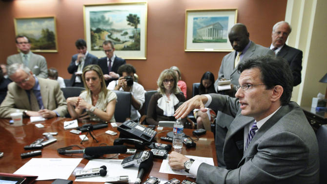 House Majority Leader Eric Cantor of Va., right, speaks to reporters during a pen and pad on Capitol Hill in Washington, Wednesday, July 6, 2011. (AP Photo/Manuel Balce Ceneta)
