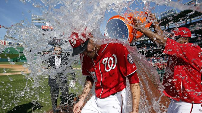 Nats clinch NL home-field edge, split with Marlins