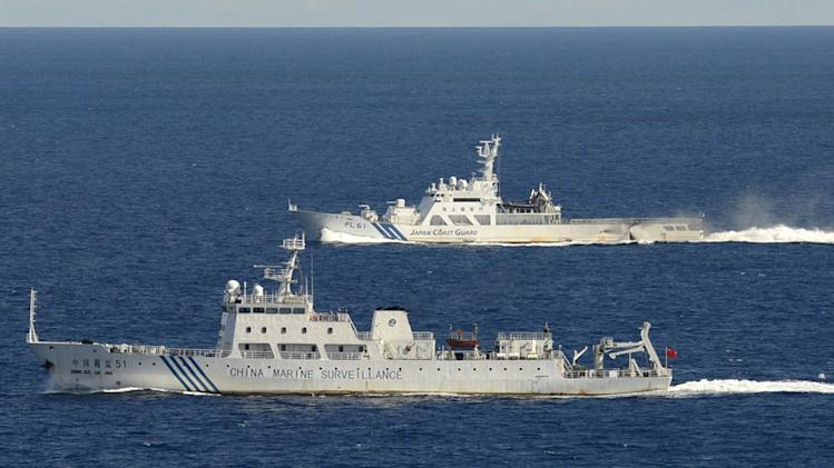 Japanese, Chinese ships exchange island warnings
