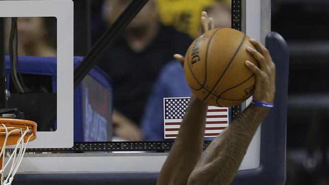 Atlanta Hawks' Josh Smith (5) dunks against Indiana Pacers' Roy Hibbert (55) during the second half of Game 5 in the first round of the NBA basketball playoff series on Wednesday, May 1, 2013, in Indianapolis. (AP Photo/Darron Cummings)