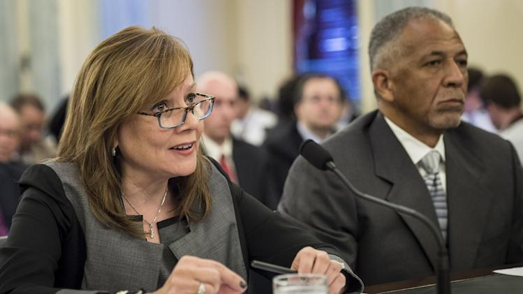 Mary Barra (L), Chief Executive Officer of the General Motors Company, speaks during a Senate committee hearing on July 17, 2014 in Washington, DC