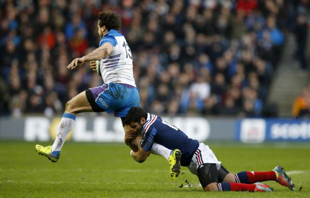 Scotland's Alex Dunbar is tackled by France's Maxime Mermoz during their Six Nations rugby union match at Murrayfield Stadium in Edinburgh