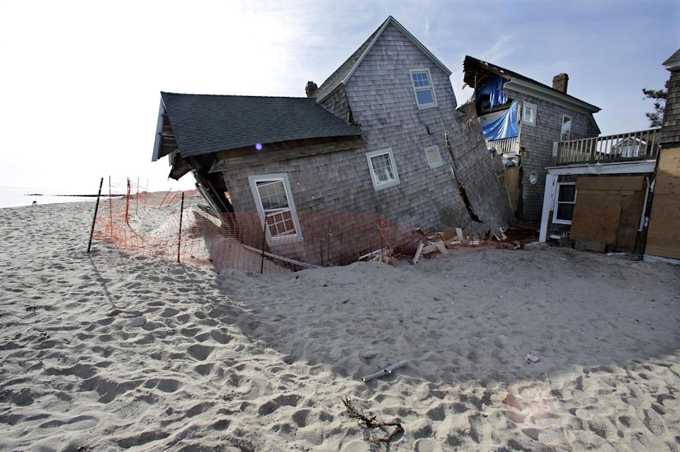 FILE - In this Jan. 3, 2013 photo, a beach front home that was severely damaged by Superstorm Sandy rests in the sand in Bay Head, N.J.   (AP Photo/Mel Evans)