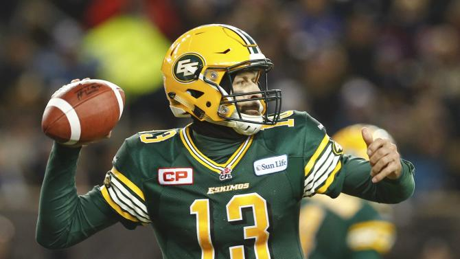 Edmonton Eskimos quarterback Mike Reilly rears back to throw a pass against the Ottawa Redblacks during the third quarter of the CFL's 103rd Grey Cup championship football game in Winnipeg