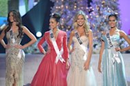 Miss Brazil (L); Miss USA (2nd-L); Miss Australia (2nd-R); and Miss Philippines during the 2012 Miss Universe Pageant at Planet Hollywood in Las Vegas, Nevada on December 19, 2012