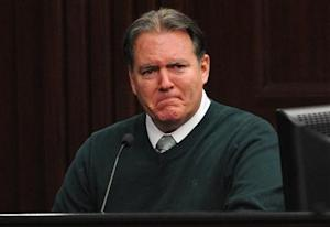 Defendant Dunn reacts on the stand during testimony in his own defense during his murder trial in Duval County Courthouse in Jacksonville