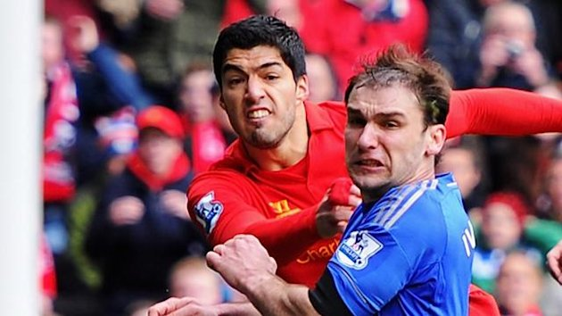 Luis Suarez of Liverpool shoots wide under a challenge from Branislav Ivanovic of Chelsea during the Barclays Premier League match between Liverpool and Chelsea at Anfield on April 21, 2013 (Getty)