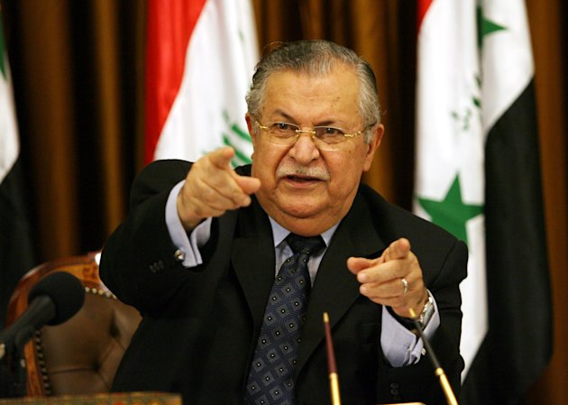 FILE - In this Aug. 17, 2007 file photo, Iraq's President Jalal Talabani talks to reporters in Baghdad, Iraq. Iraq's president on Saturday, May 26, 2012 urged the nation's bickering factions to resolve the bitter political dispute that has gripped the government for nearly six months, warning that the crisis threatens to split the country.(AP Photo/ Hadi Mizban, Pool, File)