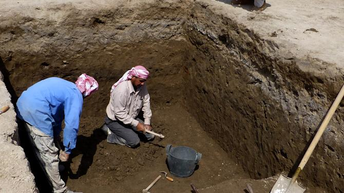 This photo taken on March 31, 2013 photo provided by Manchester University professor Stuart Campbell shows excavation in progress at Tell Khaiber, Iraq. A British archaeologist says he and his colleagues have unearthed a huge, rare complex near the ancient city of Ur in southern Iraq, home of the biblical Abraham. Stuart Campbell of Manchester University's Archaeology Department says it goes back about 4,000 years, around the time Abraham would have lived there. It's believed to be an administrative center for Ur. (AP Photo/Stuart Campbell)