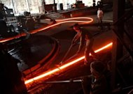 <p>Labourers work at a steel factory in the outskirts of Agartala, in India's northeastern state of Tripura, on November 1, 2012. India's prime minister on Thursday urged his re-shuffled administration to focus all its efforts on reviving the flagging economy, and said pushing through infrastructure projects would be prioritised.</p>