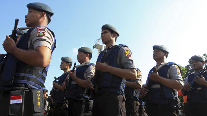 Indonesian police officers line up during a security parade in Denpasar, Bali, Indonesia  on Wednesday, Oct. 10, 2012. More than thousand Indonesian police will provide securities for the commemoration to mark the 10th anniversary of the 2002 Bali bombings, which killed 202 people - among them 88 Australians. (AP Photo/Firdia Lisnawati)