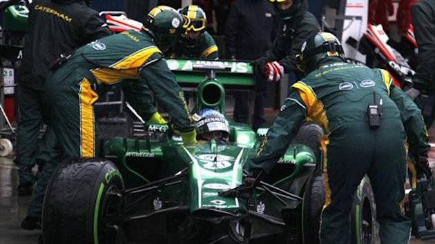 Charles Pic and his Caterham team (Reuters)