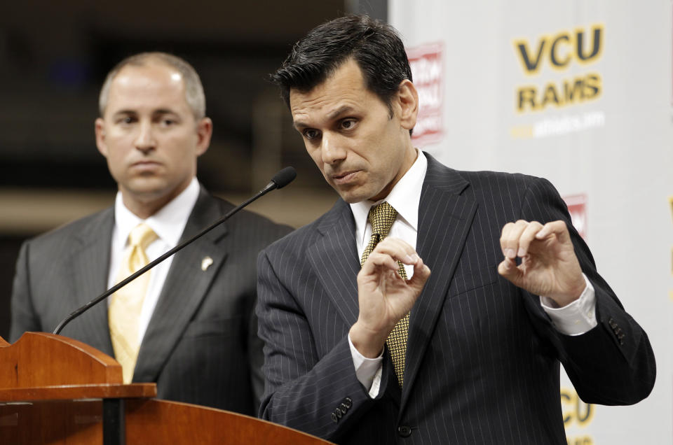 Virginia Commonwealth University president Michael Rao, right, gestures during a news conference with interim athletic director, Dave Benedict, left, Tuesday, May 15, 2012, in Richmond, Va. Rao announced that VCU would join the Atlantic 10 conference in June. (AP Photo/Steve Helber)