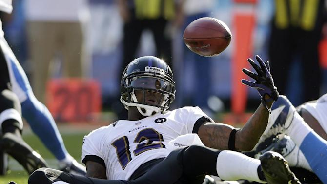 Baltimore Ravens wide receiver Jacoby Jones tries to recover his fumbles against the San Diego Chargers during the first half of an NFL football game, Sunday, Nov. 25, 2012, in San Diego. The Ravens recovered. (AP Photo/Gregory Bull)
