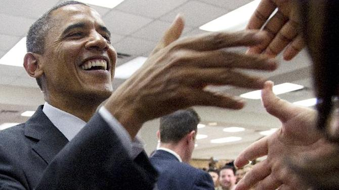 President Barack Obama greets supporters at Hillsborough Community College, Friday, June 22, 2012, in Tampa. (AP Photo/Carolyn Kaster)