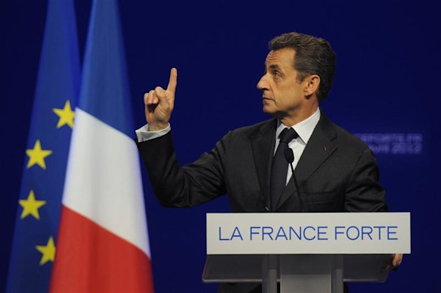 France's President and UMP party candidate for the French 2012 presidential elections Nicolas Sarkozy delivers his speech at a rally as he campaigns for his re-election in Dijon April 27, 2012.    REUTERS/Philippe Wojazer  (FRANCE - Tags: POLITICS ELECTIONS)