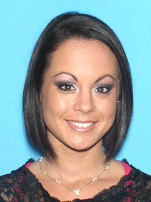 "This undated photo provided by the Orlando Police Department, shows Michelle Parker. Family members believe that Parker was carjacked shortly after her appearance on ""The People's Court"" show last Thursday Nov. 18, 2011 in Orlando, Fla. (AP Photo/Orlando Police Dept.)"