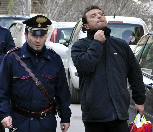 FILE In this In this Saturday, Jan. 14, 2012 file photo  Francesco Schettino, right, the captain of the luxury cruiser Costa Concordia, which ran aground off Italy's tiny Tuscan island of Isola del Gi