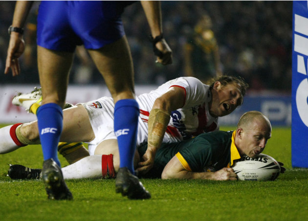 Australia's Darren Lockyer, right, dives over despite the tackle of England's Ben Westwood to score a try during the four nations rugby league final at Elland Road, Leeds, England, Saturday Nov. 19, 2