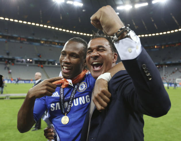 FILE - In this May 19, 2012 file photo Chelsea's Didier Drogba, left, celebrates with Dutch soccer legend Ruud Gullit at the end of the Champions League final soccer match between Bayern Munich and Ch