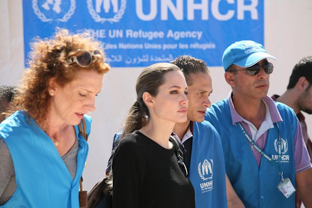 "The U.N. refugee agency's special envoy, actress Angelina Jolie, center, arrives to the Zaatari Refugees Camp in Jordan for Syrians who fled the civil war in their country, Tuesday, Sept. 11, 2012. Jolie said Tuesday she heard ""horrific"" and ""heartbreaking"" accounts from Syrian refugees in a camp which hosts about 30,000 Syrians displaced by the 18-month conflict that has so far claimed at least 23,000 lives, according to activists. (AP photo/Mohammad Hannon)"