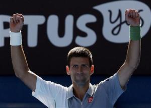 Novak Djokovic of Serbia celebrates defeating Fabio Fognini of Italy in their men's singles match at the Australian Open 2014 tennis tournament in Melbourne