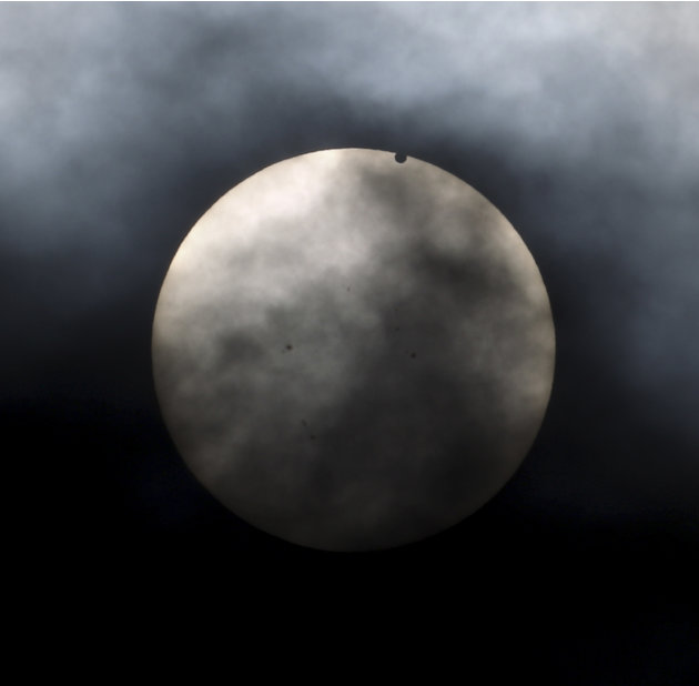 Venus begins to pass in front of the sun, as visible from New York, Tuesday, June 5, 2012. From the U.S. to South Korea, people around the world turned their attention to the daytime sky on Tuesday an