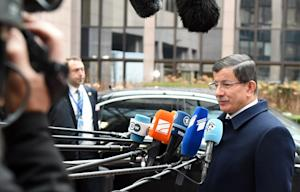 Turkish Prime Minister Ahmet Davutoglu, right, speaks …