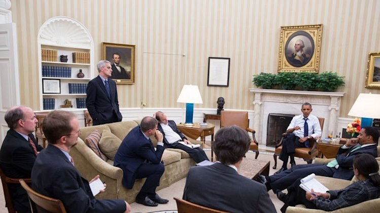 US President Barack Obama meets with senior advisors in the Oval Office to discuss Syria, on August 30, 2013