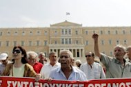 <p>Greek pensioners march during a protest organized by the communist affiliated PAME union in Athens.</p>