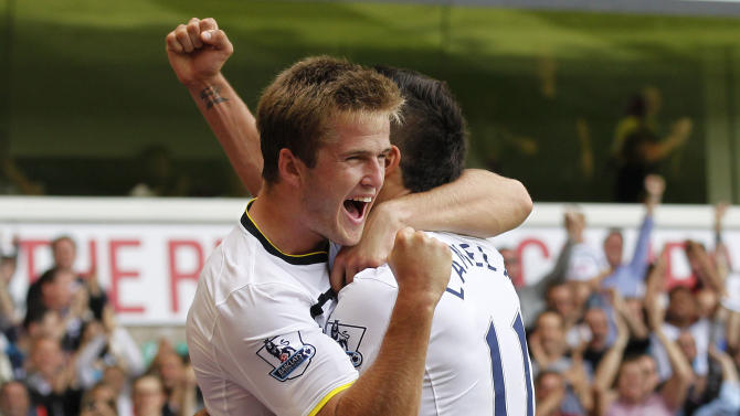 Tottenham Hotspur's Eric Dier, left, celebrates his goal against Queens Park Rangers with teammate Erik Lamela during their English Premier League soccer match at White Hart Lane, London, Sunday, Aug. 24, 2014. (AP Photo/Sang Tan)