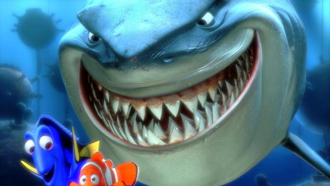 """FILE - In this promotional photo released by Disney Pixar Animation, Dory, lower left, and  Marlin, lower right, face an ocean full of perils in their efforts to rescue Nemo in this scene from Pixar Animation Studios :Finding Nemo.""""  The Walt Disney Studios has announced limited theatrical engagements for four of its classic films for the first time in 3D. """"Beauty and the Beast,"""" """" Finding Nemo,"""" """"Monsters Inc.,"""" and """"The Little mermaid,"""" will be re-released in 3D in 2012-2013. (AP Photo/Pixar Animation Studios, File)"""