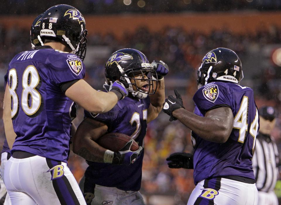 Baltimore Ravens running back Ray Rice, center, celebrates a touchdown against the Cleveland Browns with tight end Dennis Pitta (88) and fullback Vonta Leach (44) in the second quarter of an NFL football game on Sunday, Dec. 4, 2011, in Cleveland. (AP Photo/Mark Duncan)