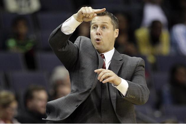Memphis Grizzlies coach David Joerger directs his team during the second half of an NBA preseason basketball game against the Milwaukee Bucks in Memphis, Tenn., Tuesday, Oct. 15, 2013. The Grizzlies w