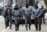 Members of Berkut anti-riot unit prepare to leave their barracks in Kiev February 22, 2014. REUTERS/Yannis Behrakis