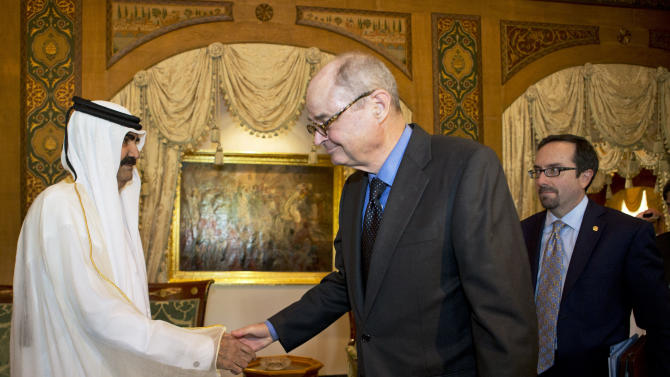 James Dobbins, center, U.S. Special Envoy to Afghanistan and Pakistan, shakes hands with Qatari Emir Hamad bin Khalifa Al Thani during his meeting with U.S. Secretary of State John Kerry, not pictured, at Wajbah Palace in Doha, Qatar, on Sunday, June 23, 2013. Dobbins is in Doha exploring prospects for U.S. talks with the Afghan Taliban. (AP Photo/Jacquelyn Martin, Pool)